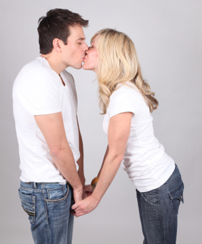 two views of couple kissing
